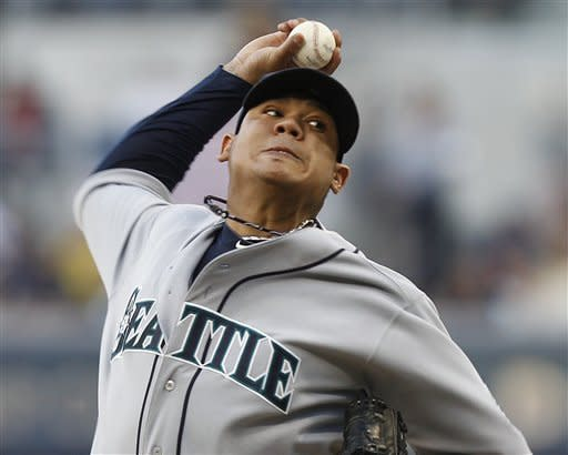 Seattle Mariners' Felix Hernandez pitches against the San Diego Padres during the first inning of a baseball game Saturday, June 23, 2012, in San Diego. (AP Photo/Lenny Ignelzi)