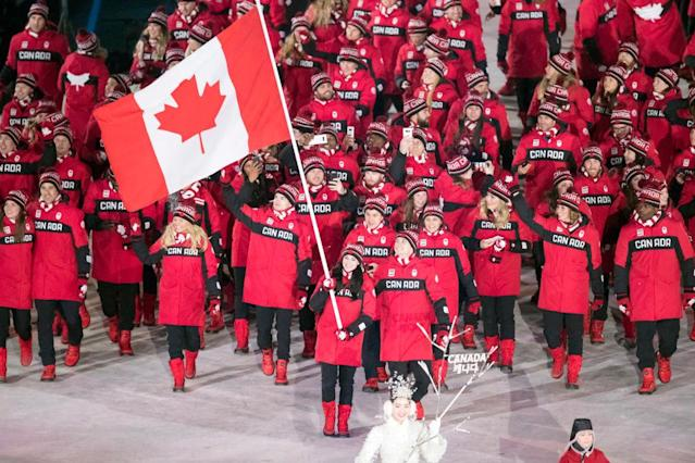 <p>Figure Skater Tessa Virtue leads Canada's national team who wear crimson red parkas with a motif of the maple leaf emblazoned on the back during the opening ceremony of the 2018 PyeongChang Games. (Photo by Roland Harrison/Action Plus via Getty Images) </p>
