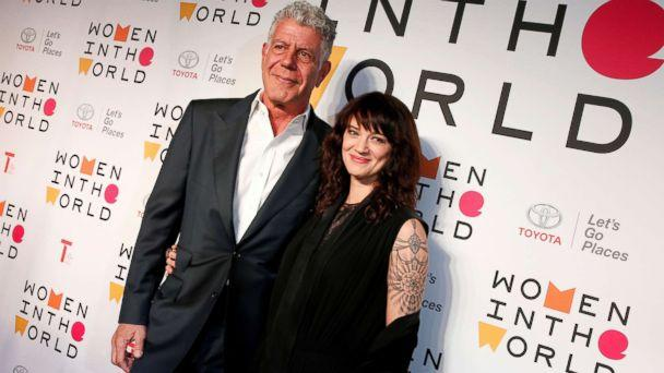 PHOTO: Anthony Bourdain poses with Italian actor and director Asia Argento for the Women In The World Summit in New York, April 12, 2018. (Brendan McDermid/Reuters, FILE)