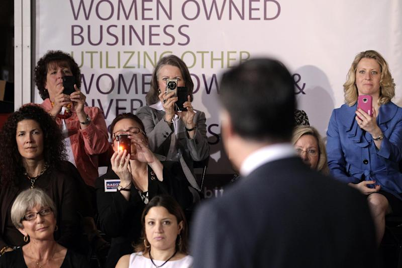 Supporters take pictures as they listen to Republican presidential candidate, former Massachusetts Gov. Mitt Romney at a campaign stop in Chantilly, Va., Wednesday, May 2, 2012. (AP Photo/Jae C. Hong)