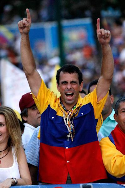Opposition presidential candidate Henrique Capriles greets supporters as he arrives for his closing campaign rally in Barquisimeto, Venezuela, Thursday, April 11, 2013. Capriles is running against ruling party candidate Nicolas Maduro in the April 14 presidential election. (AP Photo/Fernando Llano)