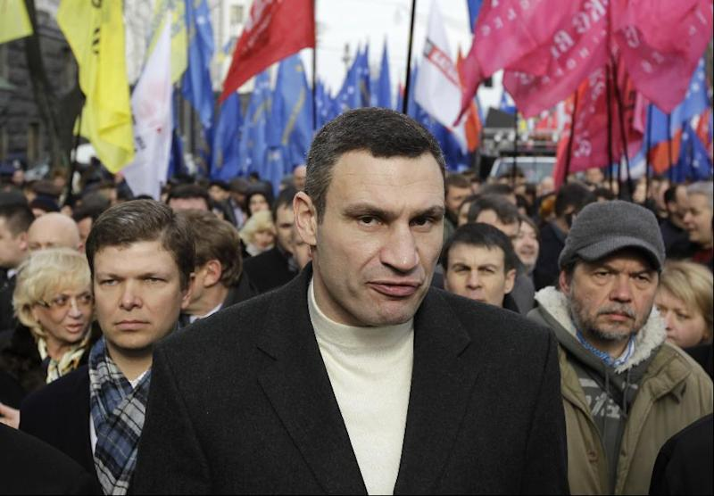 FILE - In this Tuesday, April 2, 2013 file photo Ukrainian lawmaker and chairman of the opposition party Udar (Punch), WBC heavyweight boxing champion Vitali Klitschko attends a rally in front of parliament building in Kiev, Ukraine. Towering over his fellow protest leaders, reigning world heavyweight boxing champion Vitali Klitschko has emerged as Ukraine's most popular opposition figure and has ambitions to become its next president. As massive anti-government protests continue to grip Ukraine, Wednesday Dec. 4, 2013, Klitschko is urging his countrymen to continue their fight to turn this ex-Soviet republic into a genuine Western democracy. (AP Photo/Sergei Chuzavkov, File)