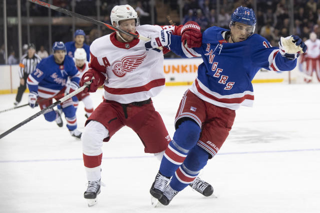 New York Rangers center Greg McKegg (14) skates against Detroit Red Wings left wing Justin Abdelkader (8) during the first period of an NHL hockey game, Wednesday, Nov. 6, 2019, at Madison Square Garden in New York. (AP Photo/Mary Altaffer)