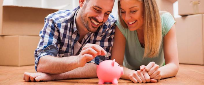 Young couple is saving money in their new home