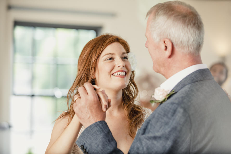 Beautiful bride is enjoying a dance with her father on her wedding day.