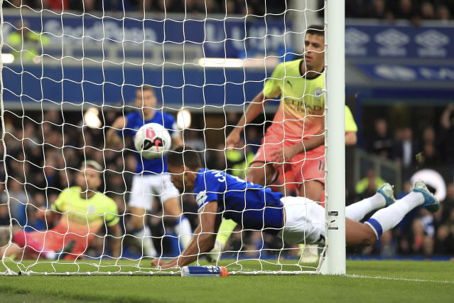 Everton's Dominic Calvert-Lewin dives in to score his side's first goal of the game against Manchester City during their English Premier League soccer match at Goodison Park in Liverpool, England, Saturday Sept. 28, 2019. (Peter Byrne/PA via AP)