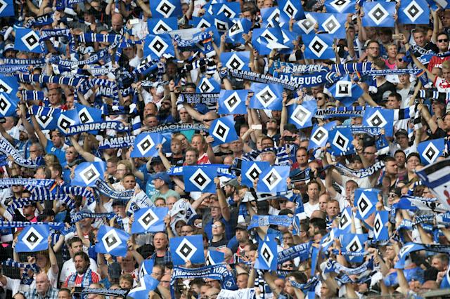 Soccer Football - Bundesliga - Hamburger SV v Borussia Moenchengladbach - Volksparkstadion, Hamburg, Germany - May 12, 2018 General view of a Hamburger SV fans holding up banners before the match REUTERS/Fabian Bimmer DFL RULES TO LIMIT THE ONLINE USAGE DURING MATCH TIME TO 15 PICTURES PER GAME. IMAGE SEQUENCES TO SIMULATE VIDEO IS NOT ALLOWED AT ANY TIME. FOR FURTHER QUERIES PLEASE CONTACT DFL DIRECTLY AT + 49 69 650050
