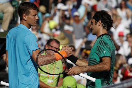Mar 30, 2017; Miami, FL, USA; Roger Federer of Switzerland (R) shakes hands with Tomas Berdych of the Czech Republic (L) after their match in a men's singles quarter-final during the 2017 Miami Open at Crandon Park Tennis Center. Federer won 6-2, 3-6, 7-6(6). Geoff Burke-USA TODAY Sports