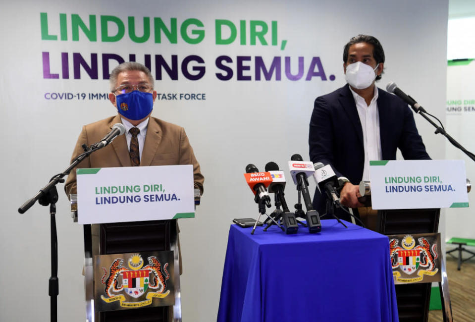 Health Minister Datuk Seri Dr Adham Baba and Science, Technology and Innovation Minister Khairy Jamaluddin during the Covid-19 Immunisation Task Force (CITF) press conference in Putrajaya, June 14, 2021. — Bernama pic