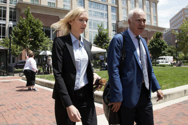 <p>Paul Manafort's former bookkeeper Heather Washkuhn, left, walks to the Alexandria Federal Courthouse in Alexandria, Va., Thursday, Aug. 2, 2018, to testify at President Donald Trump's former campaign chairman's tax evasion and bank fraud trial. Washkuhn testified that Manafort kept her in the dark about the foreign bank accounts he was using to buy millions in luxury items and personal expenses. (Photo: Manuel Balce Ceneta/AP) </p>