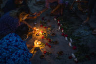 Women light candles during a candlelight vigil to remember those who died during the military junta's violent response to anti-coup demonstrations in Yangon, Myanmar Friday, April 16, 2021. Opponents of Myanmar's ruling junta went on the political offensive Friday, declaring they have formed an interim national unity government with members of Aung San Suu Kyi's ousted cabinet and major ethnic minority groups. (AP Photo)