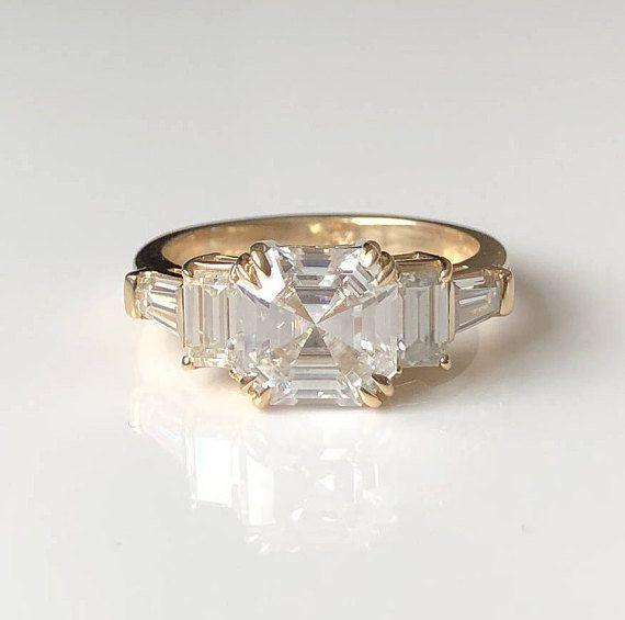 """<i><a href=""""https://www.etsy.com/listing/582844756/asscher-cut-moissanite-engagement-ring?ref=shop_home_active_18"""" target=""""_blank"""">Buy it fromTrudyGems on Etsy</a>for $3,200.</i>"""