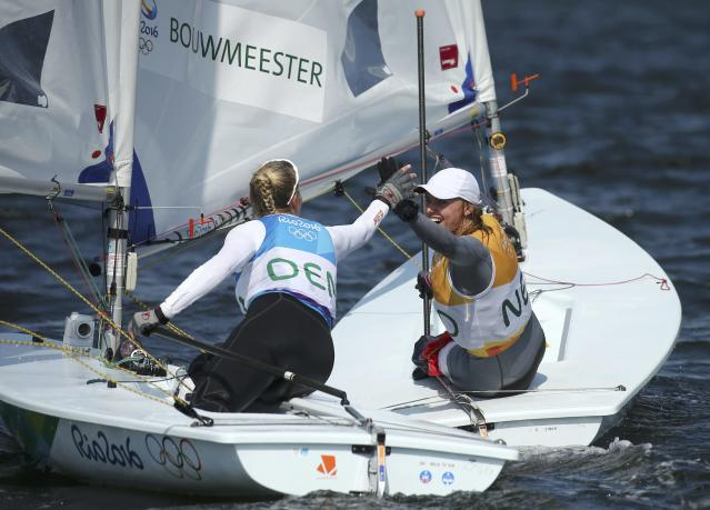 2016 Rio Olympics - Sailing - Final - Women's One Person Dinghy - Laser Radial - Medal Race - Marina de Gloria - Rio de Janeiro, Brazil - 16/08/2016. Marit Bouwmeester (NED) of Netherlands is congratulated by Anne-Marie Rindom (DEN) of Denmark. REUTERS/Benoit Tessier FOR EDITORIAL USE ONLY. NOT FOR SALE FOR MARKETING OR ADVERTISING CAMPAIGNS.