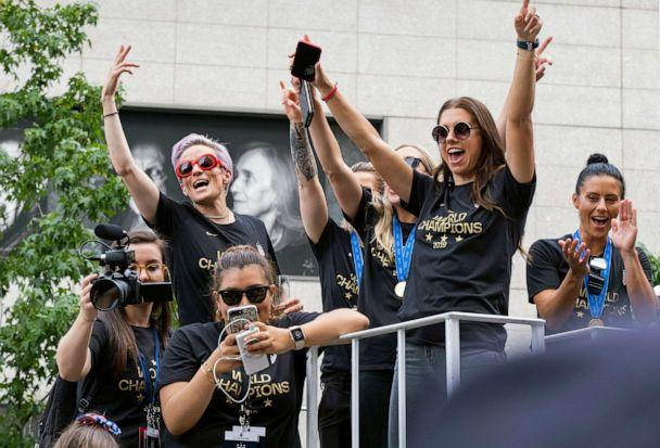 PHOTO:Members of the U.S. women's soccer team, including Megan Rapinoe, left, and Alex Morgan, right, stand on a float before being honored with a ticker tape parade along the Canyon of Heroes in New York, July 10, 2019. (Craig Ruttle/AP)
