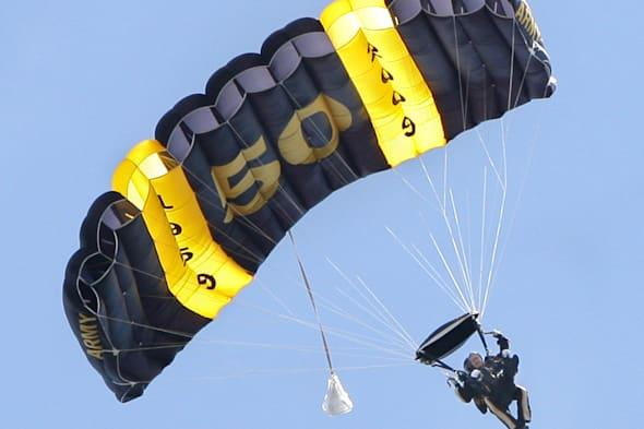 President George H.W. Bush comes in for a landing while parachuting over Kennebunkport on Friday, J