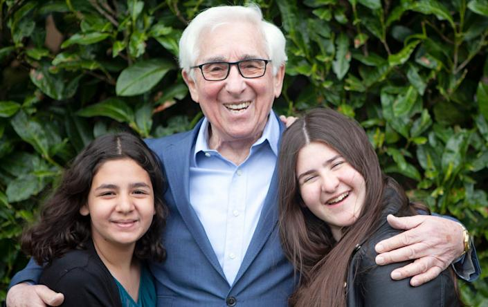 Holocaust survivor Saul Erner, aged 86, with his granddaughters - Sian Bonnell