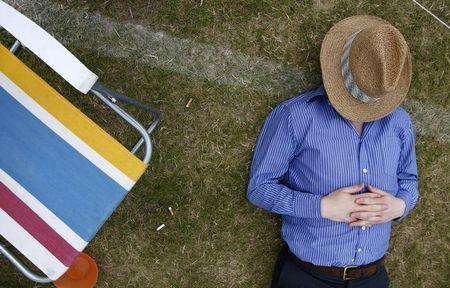 Man sleeps during final of Gold Cup British Open Polo Championship match at Cowdray Park