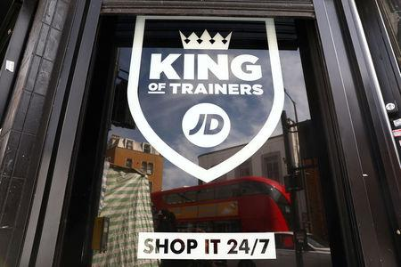 FILE PHOTO: A sign for a JD Sports store is displayed in a window in London, Britain April 11, 2017.  REUTERS/Neil Hall/File Photo