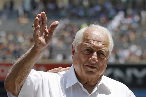 FILE - Hall of Fame manager Tommy Lasorda waves to the crowd before a baseball game at Yankee Stadium in New York, in this June 10, 2015, file photo. Tommy Lasorda, the fiery Hall of Fame manager who guided the Los Angeles Dodgers to two World Series titles and later became an ambassador for the sport he loved during his 71 years with the franchise, has died. He was 93. The Dodgers said Friday, Jan. 8, 2021, that he had a heart attack at his home in Fullerton, California. (AP Photo/Kathy Willens, File)