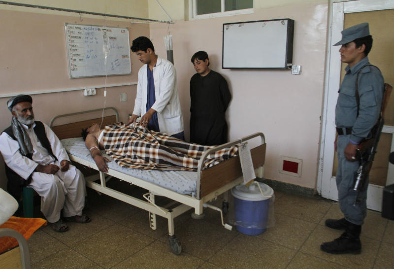 An injured Afghan man receives treatment at a hospital after a suicide bomb explosion in Kandahar province, southwest of Kabul, Afghanistan, Saturday, Aug. 31, 2013. A suicide bomber detonated his explosives near a police checkpoint and a bank in southern Afghanistan on Saturday, killing several people, officials said. Most of the victims were civilians. Along with the badly damaged branch building of the New Kabul Bank, several small shops and vehicles were damaged. (AP Photo/Allauddin Khan)
