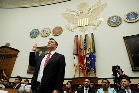 "FBI Deputy Assistant Director Peter Strzok is sworn in prior to testifying before House Committees on the Judiciary and Oversight & Government Reform joint hearing on ""Oversight of FBI and DOJ Actions Surrounding the 2016 Election"" in Washington, U.S., July 12, 2018.  REUTERS/Joshua Roberts"