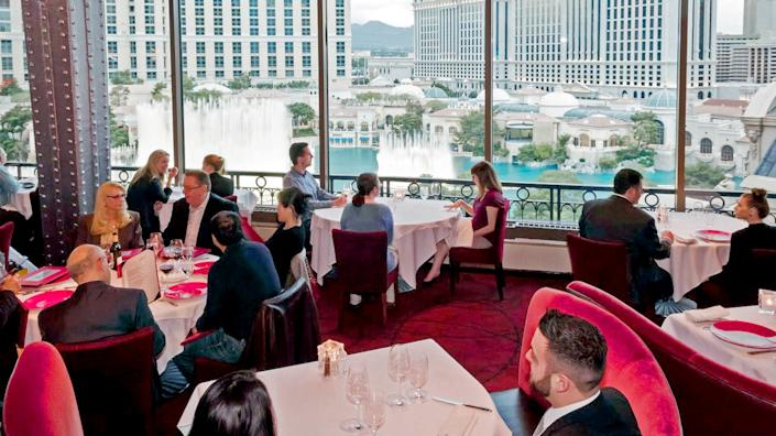 """The Eiffel Tower Restaurant at Paris Las Vegas will reopen Thursday. Diners can watch the Bellagio fountains while they eat. <span class=""""copyright"""">(Patrick Gray-Kabik Photo Group / Eiffel Tower Restaurant)</span>"""