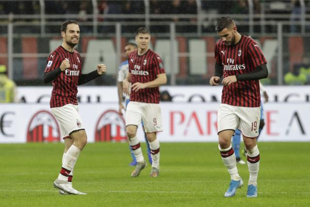 AC Milan's Giacomo Bonaventura, left, celebrates after scoring his side's opening goal during the Serie A soccer match between AC Milan and Napoli, at the San Siro stadium in Milan, Italy, Saturday, Nov. 23, 2019. (AP Photo/Luca Bruno)