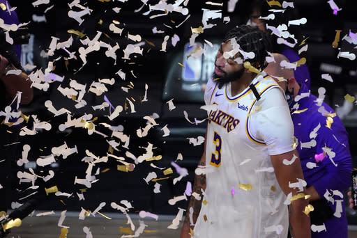 Los Angeles Lakers' Anthony Davis (3) celebrates after the Lakers defeated the Miami Heat 106-93 in Game 6 of basketball's NBA Finals Sunday, Oct. 11, 2020, in Lake Buena Vista, Fla. (AP Photo/Mark J. Terrill)