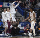 Florida State's Terance Mann (14) celebrates a basket during the second half of a second round men's college basketball game against Murray State in the NCAA tournament, Saturday, March 23, 2019, in Hartford, Conn. (AP Photo/Jessica Hill)