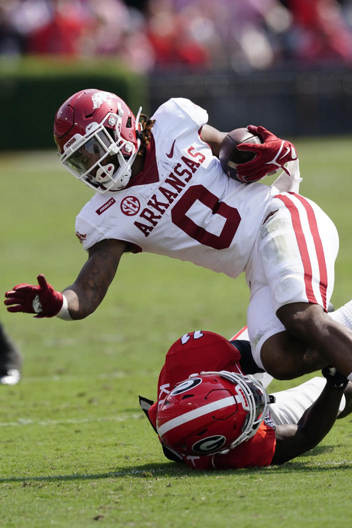 Arkansas running back AJ Green (0) is tackled by Georgia defensive back Derion Kendrick (11) during the first half of an NCAA college football game Saturday, Oct. 2, 2021, in Athens, Ga. (AP Photo/John Bazemore)
