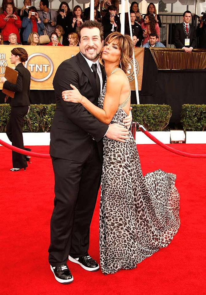 "TV Guide Network's red carpet correspondents Joey Fatone and Lisa Rinna pose for a cute pic upon arriving at the ceremony. Joey pairs a traditional black tux with patent leather sneakers, while Lisa opts for a sexy animal print ensemble. Jeff Vespa/<a href=""http://www.wireimage.com"" target=""new"">WireImage.com</a> - January 27, 2008"