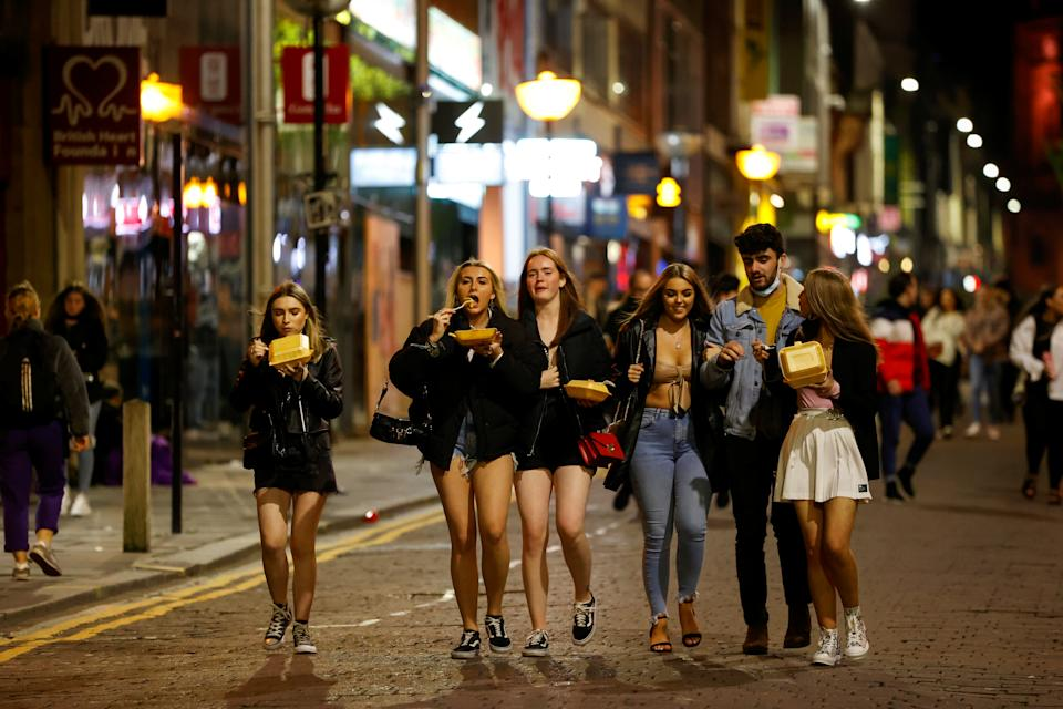 People walk and gather outside bars the night before a local lockdown amidst the spread of the coronavirus disease (COVID-19) in Liverpool, Britain October 13, 2020. REUTERS/Phil Noble