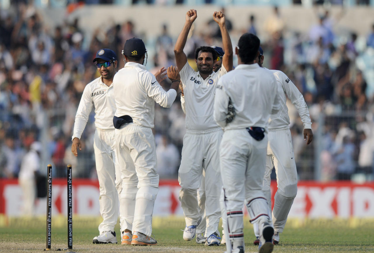 Mohammed Shami of India celebrates the wicket of Sheldon Cottrell of West Indies during day three of the first Star Sports test match between India and The West Indies held at The Eden Gardens Stadium in Kolkata, India on the 8th November 2013  Photo by: Pal Pillai - BCCI - SPORTZPICS