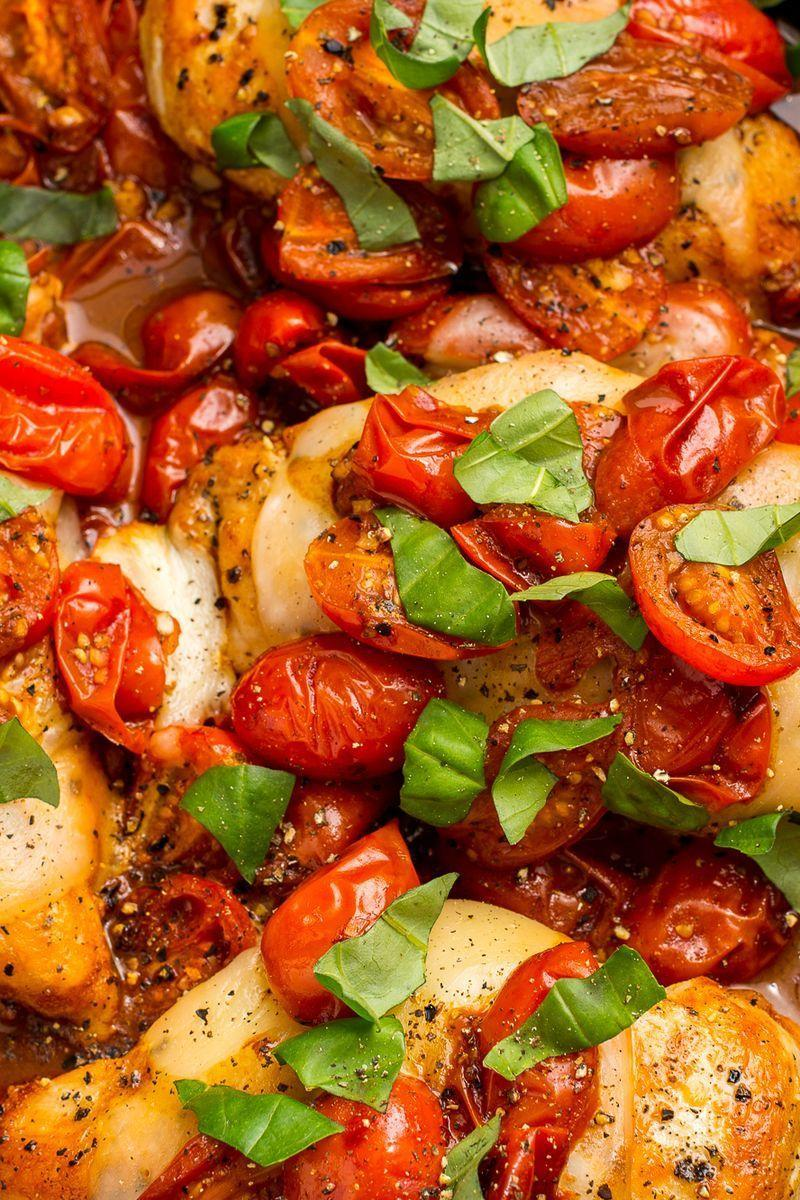 """<p>Tomatoes cooked in balsamic vinegar are the perfect sweet-tart compliment to this cheesy chicken.</p><p>Get the <a href=""""https://www.delish.com/uk/cooking/recipes/a29018750/caprese-chicken-recipe/"""" rel=""""nofollow noopener"""" target=""""_blank"""" data-ylk=""""slk:Caprese Chicken"""" class=""""link rapid-noclick-resp"""">Caprese Chicken</a> recipe.</p>"""