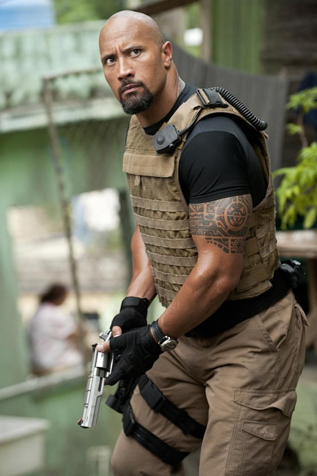 "Since his transition from wrestling god to bankable movie star, <a href=""http://movies.yahoo.com/movie/contributor/1808442134"">Dwayne Johnson</a> has reduced his brawny physique to a more svelte family-friendly size. But for this flick, Johnson got big. ""I wanted the character to be a walking, dominant, beast of a man,"" he told <a href=""http://movies.yahoo.com/movie/1810147120/info"">Yahoo! Movies</a>. Mission accomplished. He gained 30 pounds of he-man muscle for the part, sporting some guns that rival his WWE glory days."