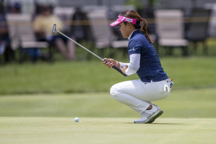 Nasa Hataoka prepares to putt on the 18th hole during the first round of the Meijer LPGA Classic golf tournament at the Blythefield Country Club in Belmont, Mich., Thursday, June 17, 2021. (Cory Morse/The Grand Rapids Press via AP)