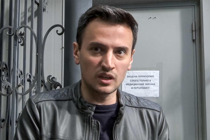 In this photo taken from video, Alexander Solovyov speaks to the media as police search at his country home outside Moscow, Russia, Tuesday, June 1, 2021. Russian authorities are cracking down on dissent before a crucial parliamentary election in September, in what a leading Kremlin critic on Tuesday described as an attempt to sideline opponents. Solovyov's home was searched Tuesday along with homes of several other opposition activists. (AP Photo/Vladimir Kondrashov)