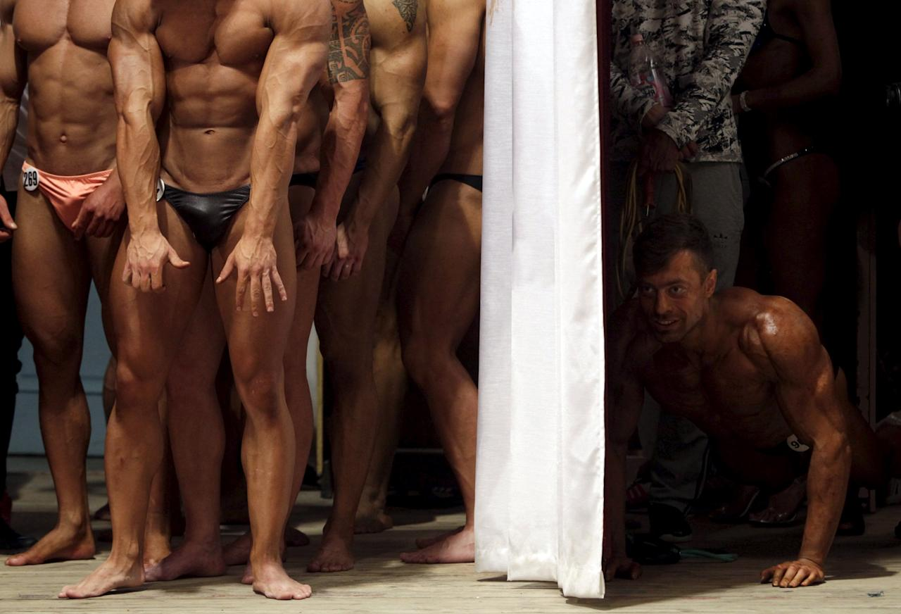 Participants wait backstage during a regional bodybuilding and fitness competition in Stavropol, southern Russia April 4, 2015. More than 100 people from the Stavropol region, Krasnodar, Moscow and other cities competed in several categories, according to organizers. REUTERS/Eduard Korniyenko      TPX IMAGES OF THE DAY