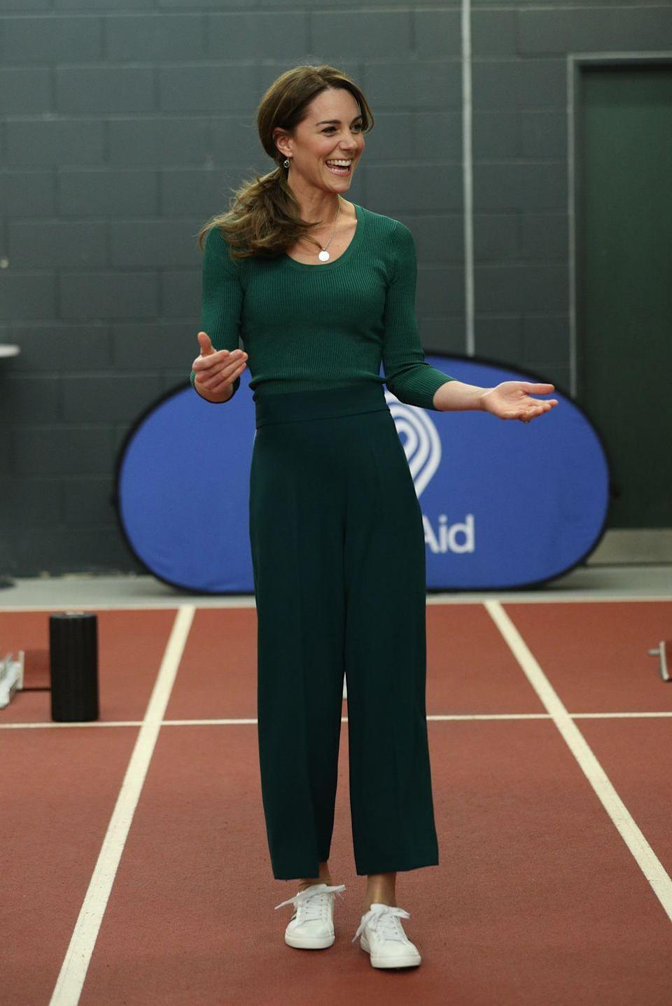 """<p>Kate chose an <a href=""""https://www.townandcountrymag.com/society/tradition/a31112240/kate-middleton-green-athleisure-look-sportsaid-photos/"""" rel=""""nofollow noopener"""" target=""""_blank"""" data-ylk=""""slk:all-green athleisure ensemble"""" class=""""link rapid-noclick-resp"""">all-green athleisure ensemble</a> to visit a SportsAid event at the London Stadium in Stratford. The wide-leg pants are <a href=""""https://twitter.com/kateroyalcloset/status/1232637744230412288"""" rel=""""nofollow noopener"""" target=""""_blank"""" data-ylk=""""slk:reportedly"""" class=""""link rapid-noclick-resp"""">reportedly</a> from Zara, one of the Duchess's favorite shops. And she accessorized the look with a sweet necklace engraved with """"GCL""""—<a href=""""https://www.townandcountrymag.com/style/fashion-trends/a30642875/kate-middleton-gold-necklace-prince-george-louis-princess-charlotte/"""" rel=""""nofollow noopener"""" target=""""_blank"""" data-ylk=""""slk:a tiny tribute to her three children: George, Charlotte, and Louis"""" class=""""link rapid-noclick-resp"""">a tiny tribute to her three children: George, Charlotte, and Louis</a>.</p>"""