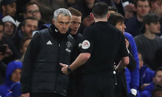 Michael Oliver and Jose Mourinho have a chat