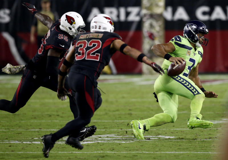 Seattle Seahawks quarterback Russell Wilson provided one of the season's best highlights on a long play to Doug Baldwin. (AP)