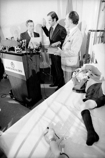 PHOTO: Senator Joseph Biden takes the oath of office from the Senate's secretary, Frank Valeo with his father-in-law Robert Hunter and son Joseph Beau Biden at his side, in Beau's hospital room, Wilmington, Del.,  Jan. 05, 1973. (Bettmann Archive)