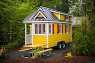 """<p>Just one of the homes in Oregon's Mt. Hood Tiny House Village, """"Savannah"""" features yellow cedar plank siding with red shutters and white trim. So welcoming!</p><p><a class=""""link rapid-noclick-resp"""" href=""""https://go.redirectingat.com?id=74968X1596630&url=https%3A%2F%2Fwww.tripadvisor.com%2FShowUserReviews-g52127-d909607-r464373430-Mt_Hood_Village_RV_Resort-Welches_Clackamas_County_Oregon.html&sref=https%3A%2F%2Fwww.countryliving.com%2Fhome-design%2Fg1887%2Ftiny-house%2F"""" rel=""""nofollow noopener"""" target=""""_blank"""" data-ylk=""""slk:PLAN YOUR TRIP"""">PLAN YOUR TRIP</a> <a class=""""link rapid-noclick-resp"""" href=""""https://www.countryliving.com/life/travel/g3595/tour-tiny-house-village/"""" rel=""""nofollow noopener"""" target=""""_blank"""" data-ylk=""""slk:SEE INSIDE"""">SEE INSIDE</a><br></p>"""