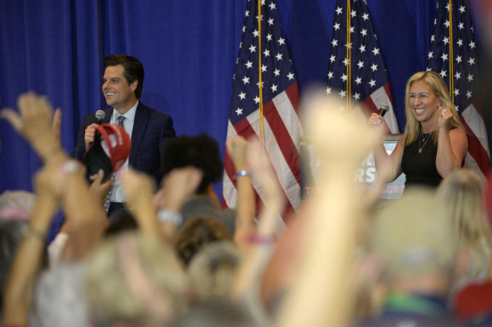 Rep. Matt Gaetz, left, and Rep. Marjorie Taylor Greene address attendees during a rally on May 7 in the Villages, Fla. (Phelan M. Ebenhack/AP)