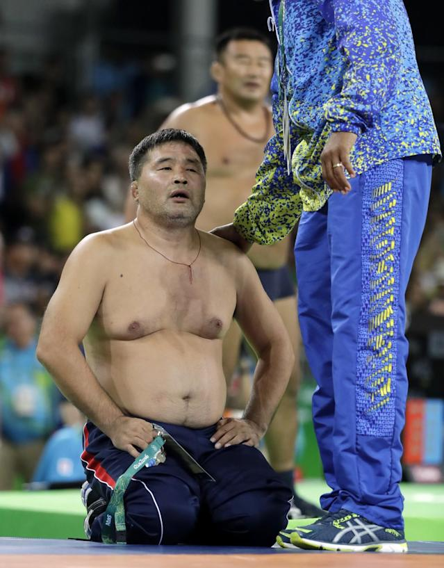 <p>Coaches for Mongolia's Mandakhnaran Ganzorig strip in protest after a loss to Uzbekistan's Ikhtiyor Navruzov during the men's 65-kg freestyle bronze medal wrestling match at the 2016 Summer Olympics in Rio de Janeiro, Brazil, Saturday, Aug. 20, 2016. (AP) </p>