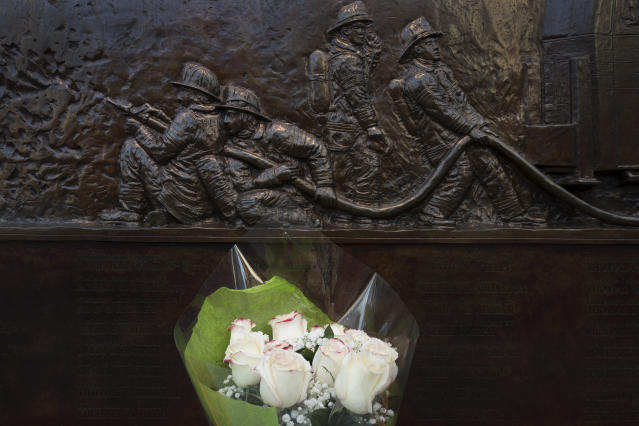 <p>A bouquet of roses is placed at a memorial wall outside Ladder 10 Engine 10 , Monday, Sept. 11, 2017, at the World Trade Center in New York. Thousands of 9/11 victims' relatives, survivors, rescuers and others gathered Monday at the World Trade Center to remember the deadliest terror attack on American soil. During the attacks of Sept. 11, 2001, 343 firefighters were killed. (AP Photo/Mark Lennihan) </p>