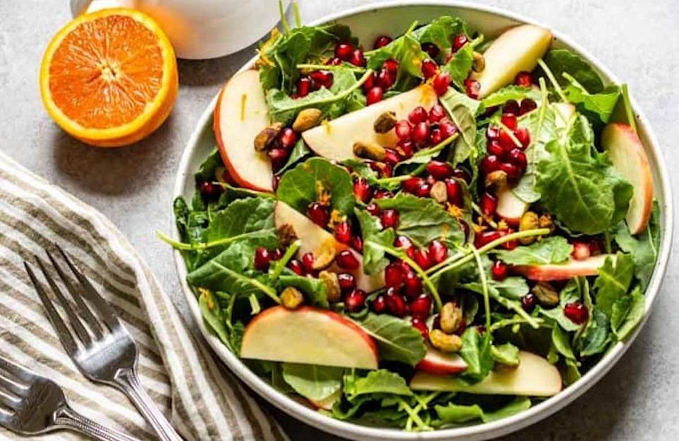 """<p>In the midst of hearty casseroles, it's always nice to have a lighter option during Thanksgiving. Packed with apples and kale — an <a href=""""https://www.theactivetimes.com/healthy-living/15-foods-boost-your-immune-system?referrer=yahoo&category=beauty_food&include_utm=1&utm_medium=referral&utm_source=yahoo&utm_campaign=feed"""" rel=""""nofollow noopener"""" target=""""_blank"""" data-ylk=""""slk:immune-boosting food"""" class=""""link rapid-noclick-resp"""">immune-boosting food</a> — this flavorful salad is finished off with a homemade mustard dressing.</p> <p><a href=""""https://www.thedailymeal.com/recipes/kale-and-apple-salad-maple-mustard-dressing-recipe?referrer=yahoo&category=beauty_food&include_utm=1&utm_medium=referral&utm_source=yahoo&utm_campaign=feed"""" rel=""""nofollow noopener"""" target=""""_blank"""" data-ylk=""""slk:For the Kale and Apple Salad with Maple Mustard Dressing recipe, click here."""" class=""""link rapid-noclick-resp"""">For the Kale and Apple Salad with Maple Mustard Dressing recipe, click here.</a></p>"""