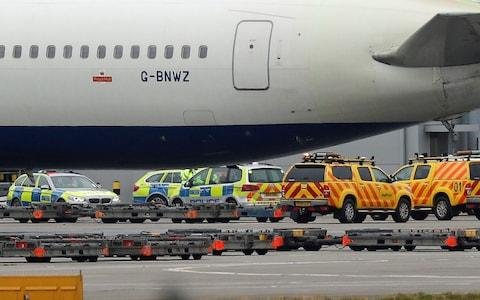 Police and airside operations vehicles at Heathrow Airport where a man, aged in his 40s, died after two airport vehicles crashed on the airfield - Credit: Steve Parsons/PA Wire
