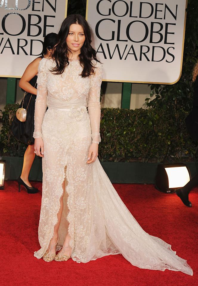 """<b>Jessica Biel</b><br><b>Grade: D-</b><br><br><span style=""""font-size:10.0pt;font-family:Arial;"""">Newly engaged Jessica Biel looked ready to walk down the aisle in this lacy Elie Saab mess of a dress. All that was missing was fiancé Justin Timberlake -- and her engagement ring!</span>"""