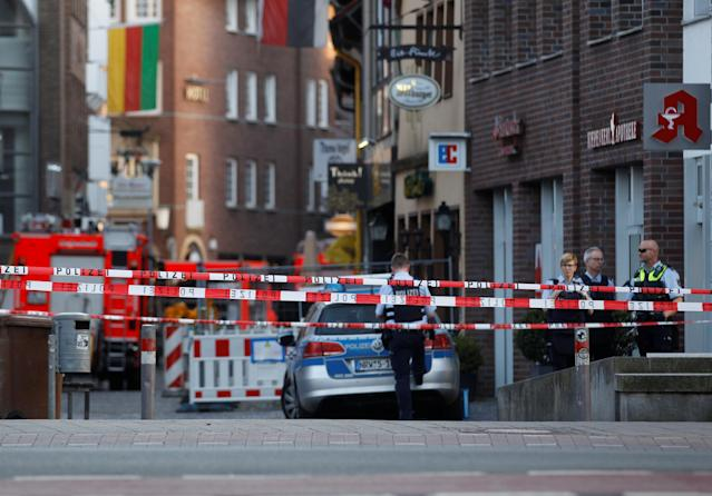 <p>Police stands guard in a street near a place where a man drove a van into a group of people sitting outside a popular restaurant in the old city centre of Muenster, Germany, April 7, 2018. (Photo: Leon Kuegeler/Reuters) </p>